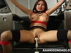 Busty dark-haired getting her raw pussy machine fucked