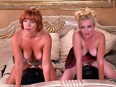 Two girls riding two shag machine on a sofa