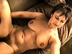 Yvonne's immense bra-stuffers hard nipples and hairy pussy