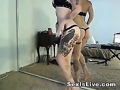 Gothic tattooed blond in undergarments is playful