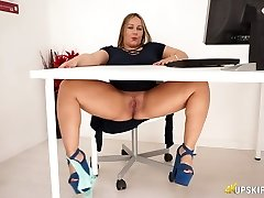 Chubby English nympho Ashley Rider rubs her giant labia in the office