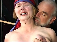 Nice young blonde with perky tits is confined for nipple clamp play