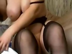 I am this crazy bitch with huge amateur tits, who is wearing high heels, while fucking a enormous black dildo.