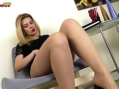 Busty blonde in pantyhose fingers herself