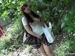 Gorgeous and curious ginger-haired Asian teen watches sex on the street and masturbates