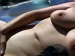Horny MILF splashing by the pool