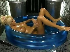 Kerrie Lee in a paddling pool coated in lube