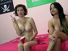 Duo of big boobed black-haired hookers smoke after hot threesome