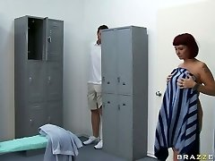 Young dude spying big-chested red haired milf Carrie Ann taking a shower