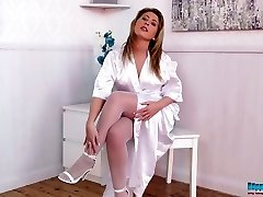 Sexy sandy-haired nurse Sophie Star posing temptingly in white nylon stockings