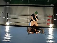 Busty hairy Jap torn up in a grappling ring