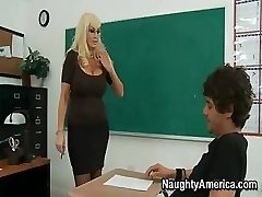 This busty light-haired Cougar of a teacher needs some really rough sex