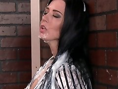 Muddy bitch throating huge sex toy through the gloryhole