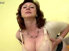 Huge titted mother Jana loves to play with her unshaved pussy