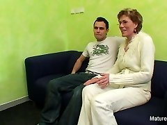 Granny observes porn before getting fucked by a younger guy