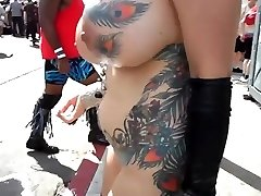 Buxomy mature exhibitionist with fondling in public