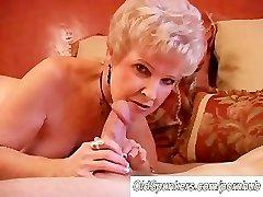 Gorgeous cougar deep throats cock and licks cum