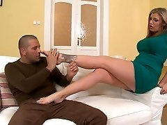Busty tattooed milf gives great footjob to nasty young guy