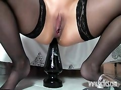 Busty mature pummeling enormous dildos