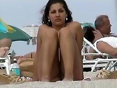 A voyeur capturing cootchies and tits of gals on a bare beach