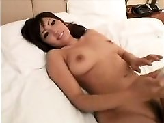 Wondrous  Asian girl with marvelous big udders gives a sensua