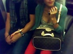 downblouse stripped to the waist in Paris subway