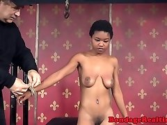 Breast bonded black victim throated with strapon