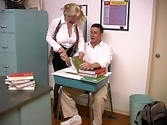 Mature platinum-blonde with enormous breasts porked by student in the classroom