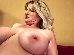 Obese Granny Undresses And Show Tits