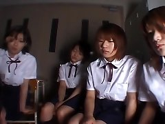 Four Japanese college girls slobbering on teacher