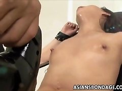 Asian stunner bond and fuckd by a fucking machine