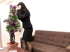 Girl in suit and stockings masturbates when she is alone