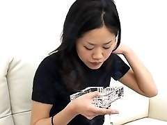 Pretty Asian smoking and spitting