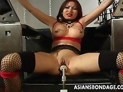 Busty dark-haired getting her wet gash machine fucked