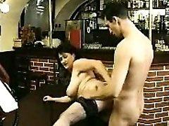 Brunette in stockings sucks hefty cock and fucks it