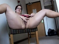 Busty mature BBW in pantyhose and mini microskirt