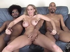 Busty towheaded cougar, Julia Ann likes to have sex with two black guys at the same time