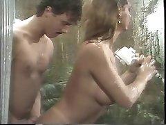 Classic buxomy porn queen sucks gigantic cock in the shower then romps