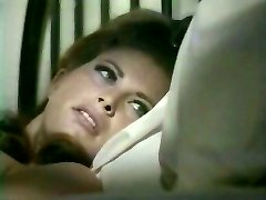 Sex thirsty wifey seduces her sleeping spouse kissing his ear
