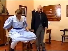 European vintage spanking vignette with a teen brunette