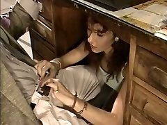 Promiscuous secretary gives her boss a blowjob under the table