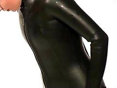 Dressing in beavertail wetsuit & knee shoes, wearing dark-hued latex catsuit