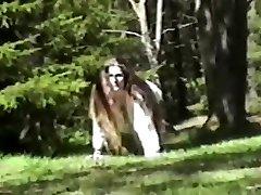 Long hair brunette strips & shows in woods full bush