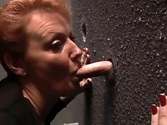 Redheaded Milf at the Gloryhole