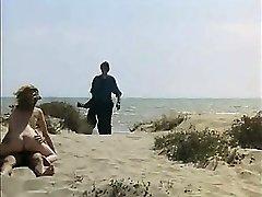Voyeur Dude wanking and fuck redhead girl on a public beach
