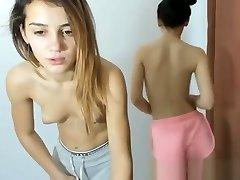 Two schoolgirls after school de-robe in front of the webcam for money.