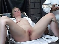 Submissive blonde gets her clit pumped by kinky sir