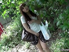 Beautiful and nosey redhead Asian teen observes sex on the street and masturbates