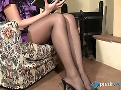 Nasty brunette sweetie Flavia looks irresistible in black nylon stocking