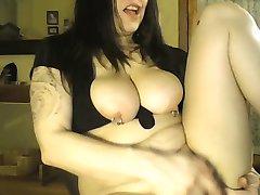 Horny pierced nipple milf plays with self